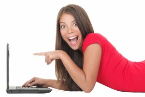 Woman excited with laptop
