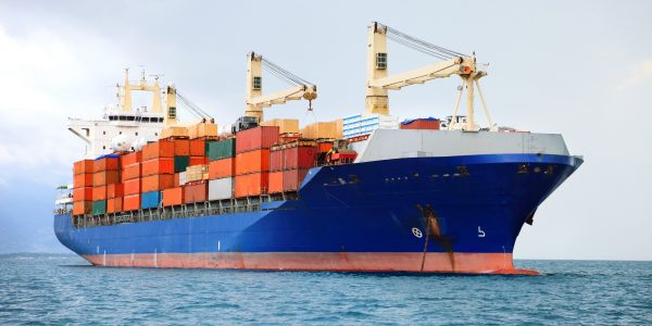 cargo container ship in mediterranean coast